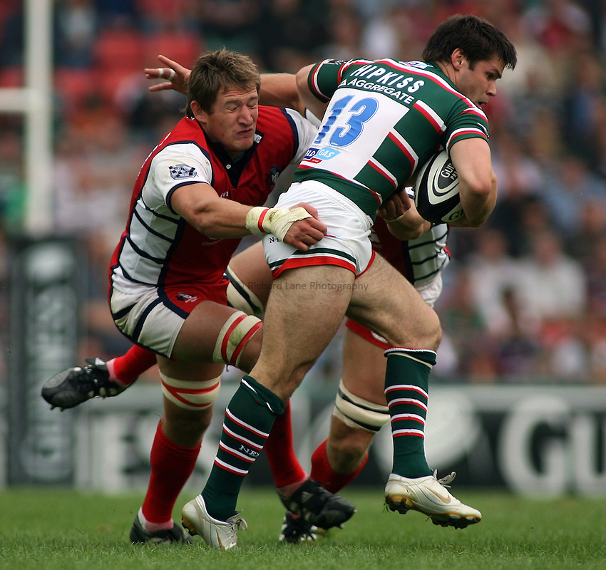 Photo: Paul Thomas..Leicester Tigers v Gloucester Rugby. Guinness Premiership. 16/09/2006...James Forrester (L) of Gloucester tackles Leicester's Dan Hipkiss.
