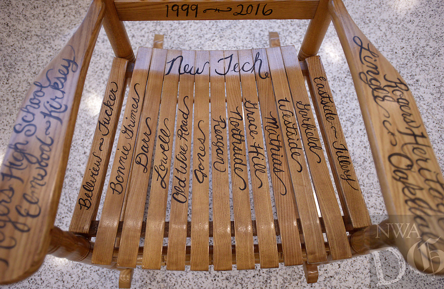 NWA Democrat-Gazette/BEN GOFF @NWABENGOFF<br /> The names of all Rogers public schools decorate a rocking chair presented to Dr. Janie Darr on Sunday June 12, 2016 during a retirement celebration for her at Rogers High School. Darr has served various roles in Rogers Public Schools over the past 46 years, including 17 years as superintendent.