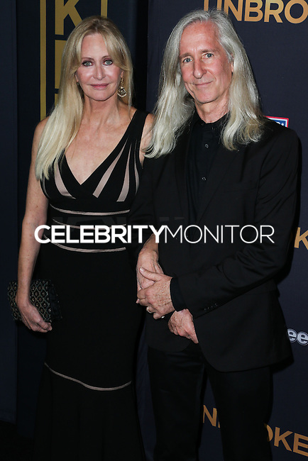 HOLLYWOOD, LOS ANGELES, CA, USA - DECEMBER 15: Cynthia Zamperini-Garris, Mick Garris arrive at the Los Angeles Premiere Of Universal Pictures' 'Unbroken' held at the Dolby Theatre on December 15, 2014 in Hollywood, Los Angeles, California, United States. (Photo by Xavier Collin/Celebrity Monitor)