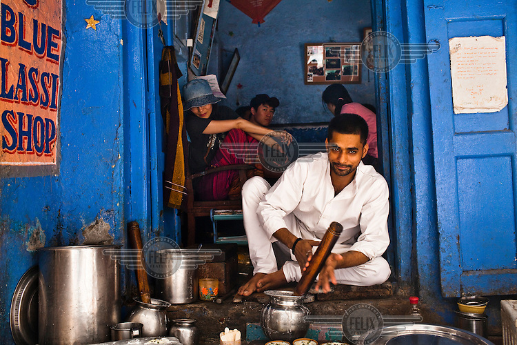 Chanchal Yadav poses for a photo while preparing lassi (a yoghurt drink) in his shop, The Blue Lassi in the ancient city of Varanasi.