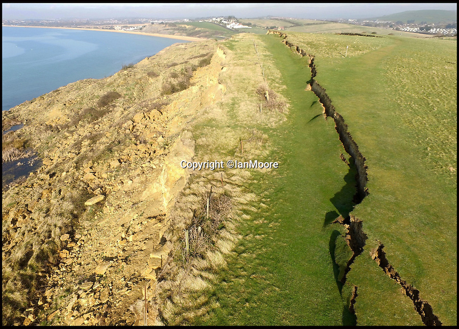 BNPS.co.uk (0202 558833)<br /> Pic: IanMoore/BNPS<br /> <br /> Birds eye view of Jurassic crack...<br /> <br /> These stunning aerial images show the dramatic extent of a huge land movement that has changed the face of Britain's Jurassic Coast.<br /> <br /> The 300 yard long crack opened up in the cliffs at Bowleaze cove near Weymouth, Dorset, after thousands of tons of earth suddenly gave way.<br />  <br /> Ian Moore flew a camera drone over the seaside beauty spot to inspect the scale of the landslip from above.