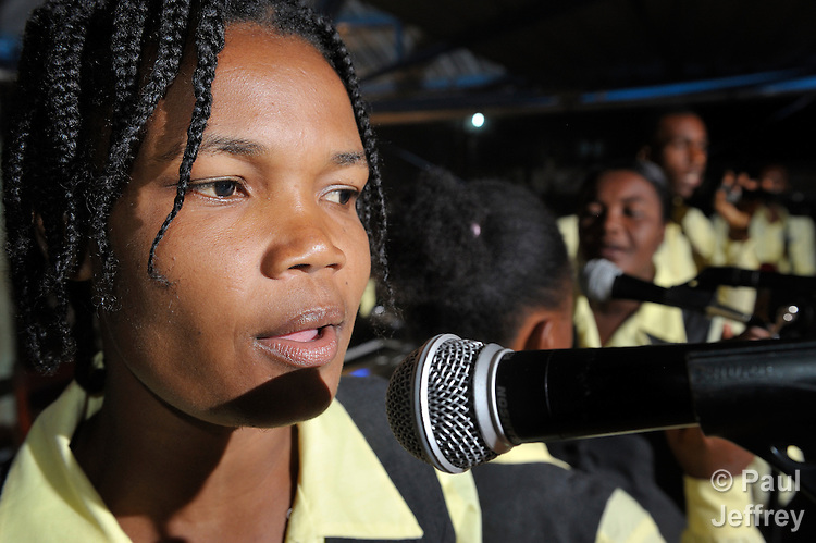 A member of the Shalom Singers during a concert. A young adult volunteer singing group in Mizak, Haiti, the group uses gospel music to spread the message of God's Shalom. It was started by the Mizak-based Haitian Artisans for Peace. HAPI, in partnership with Drew University Communities of Shalom, is the first Community of Shalom site in Latin America. Communities of Shalom operate under the assumption that God has provided each community all it needs to thrive and actualize the Shalom that God intends for humanity.