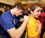 SPEARFISH, S.D. -- Brayden Simms, right, gets his shirt autographed by South Dakota State wrestler Cody Pack after their wrestling dual with the University of Wyoming Sunday afternoon at the Young Center in Spearfish, S.D.  (Photo by Richard Carlson/Inertia via dakotapress.org)