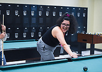 NWA Democrat-Gazette/CHARLIE KAIJO Michelle Garcia-Martinez of Rogers shoots pool, Thursday, November 21, 2019 at the Northwest Arkansas Community College game room in Bentonville.<br /> <br /> Northwest Arkansas Community College continues to study the possibility of adding dormitories to its campus. The college is investing about $10,000 in a feasibility study by Vogt Strategic Insights.