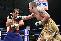 Vinny Mitchell (Dagenham, camouflage shorts) defeats Youssef Al Hamidi (Dewsbury, blue/red shorts) in a Super-Featherweight boxing contest at York Hall, Bethnal Green, promoted by Frank Warren / Sports Network - 22/05/09 - MANDATORY CREDIT: Gavin Ellis/TGSPHOTO - Self billing applies where appropriate - 0845 094 6026 - contact@tgsphoto.co.uk - NO UNPAID USE.