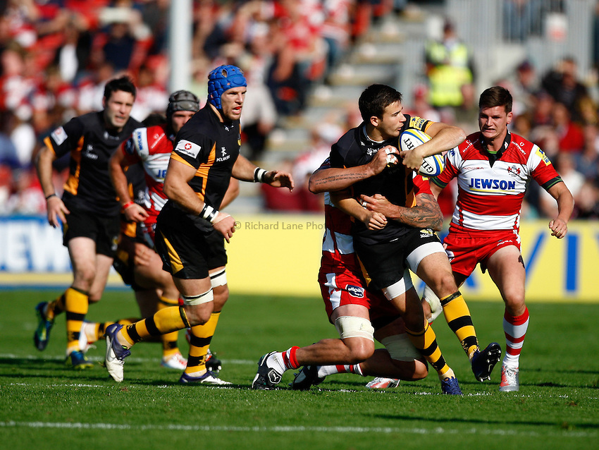 Photo: Richard Lane/Richard Lane Photography. Gloucester Rugby v London Wasps. Aviva Premiership. 22/09/2012. Wasps' Tommy Bell looks to offload in the tackle.