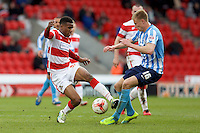 Doncaster Rovers v Coventry City, 23.4.2016<br /> Sky Bet League One<br /> Picture Shaun Flannery/Trevor Smith Photography<br /> Rovers Riccardo Calder battles with Coventry's Andy Rose.