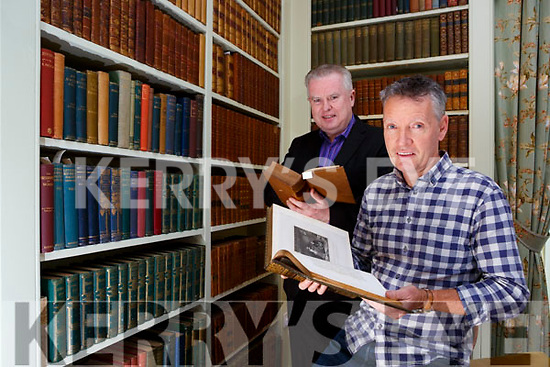 Paul Curtis Conservation bookbinder and Pat Dawson General Manager reading some of the 2000 leather bound books that have been restored  in the Kenmare Library at Killarney House