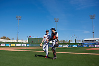 Oregon State Beavers starting pitcher Christian Chamberlain (34) and catcher Troy Claunch (17) walk off the field between innings of an NCAA game against the New Mexico Lobos at Surprise Stadium on February 14, 2020 in Surprise, Arizona. (Zachary Lucy / Four Seam Images)