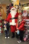 Hannah and Jack with Santa at the Christmas Customer Day in the Cottage Pharmacy 2011...(Photo credit should read Jenny Matthews www.newsfile.ie)....This Picture has been sent you under the conditions enclosed by:.Newsfile Ltd..The Studio,.Millmount Abbey,.Drogheda,.Co Meath..Ireland..Tel: +353(0)41-9871240.Fax: +353(0)41-9871260.GSM: +353(0)86-2500958.email: pictures@newsfile.ie.www.newsfile.ie.