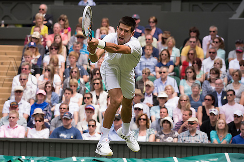 25.06.2012 London, England Novak Djokovic of Serbia  in action against Juan Carlos Ferrero of Spain during the first round of the match at Wimbledon Tennis Championships at The All England Lawn Tennis Club.