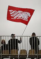 A spectator waves a Holden Racing Team flag during Day Three of the Hamilton 400 Aussie V8 Supercars Round Two at Frankton, Hamilton, New Zealand on Sunday, 19 April 2009. Photo: Dave Lintott / lintottphoto.co.nz