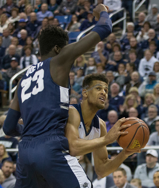 Nevada forward forward Trey Porter (15) looks to shoot over Utah State center Neemias Queta (23) in the first half of an NCAA college basketball game in Reno, Nev., Wednesday, Jan. 2, 2019. (AP Photo/Tom R. Smedes)