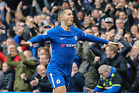 Eden Hazard of Chelsea celebrates after he scores his team's first goal of the game to make the score 1-1 during the Premier League match between Chelsea and Newcastle United at Stamford Bridge, London, England on 2 December 2017. Photo by David Horn.