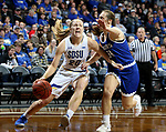 SIOUX FALLS, SD - NOVEMBER 15: South Dakota State Jackrabbits's Tori Nelson #20 takes the ball to the basket against Matti Reiner #34 from Dakota Wesleyan during their game Friday evening at the Sanford Pentagon in Sioux Falls, SD. (Photo by Dave Eggen/Inertia)