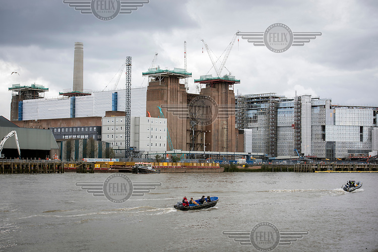 Boats on the Thames beside the Nine Elms development site and Battersea Power Station.