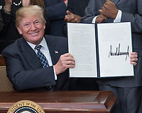 United States President Donald J. Trump signs a proclamation to honor Dr. Martin Luther King, Jr. Day in the Roosevelt Room of the White House in Washington, DC on Friday, January 12, 2018.<br /> CAP/MPI/RS<br /> &copy;RS/MPI/Capital Pictures