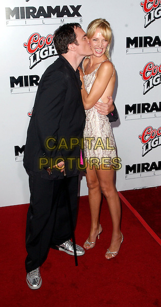 QUENTIN TARANTINO & UMA THURMAN.Kill Bill L.A. Premiere, Graumann's Chinese Theatre.full length, full-length, white silver patterend minidress, silver strappy sandals, walking stick, cane, kissing.www.capitalpictures.com.sales@capitalpictures.com.©Capital Pictures.