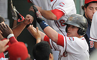 Catcher Christian Vazquez (15) of the Greenville Drive is congratulated after hitting a home run in a game against the Augusta GreenJackets on August 27, 2011, at Fluor Field at the West End in Greenville, South Carolina. Greenville defeated Augusta, 10-4. (Tom Priddy/Four Seam Images)