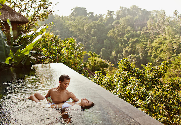A woman receives a watsu treatment in the infinity pool of a private pool villa at Ubud Hanging Gardens, Bali, Indonesia.