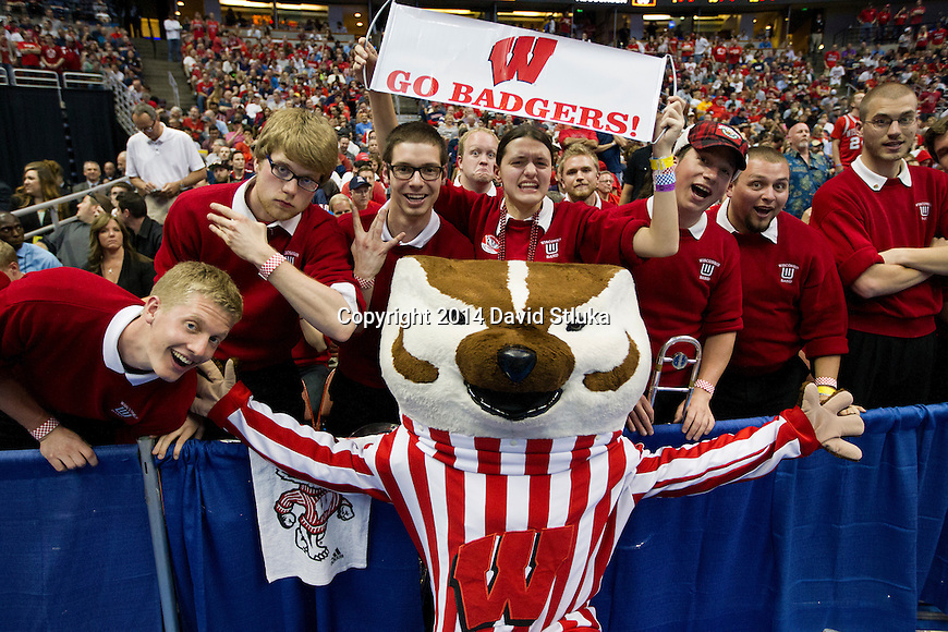 Wisconsin Badgers mascot Bucky Badger poses for a photo with the band during  the Western Regional Final NCAA college basketball tournament game against the Arizona Wildcats Saturday, March 29, 2014 in Anaheim, California. The Badgers won 64-63 (OT). (Photo by David Stluka)