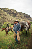 USA, Oregon, Joseph, Cowboys Todd Nash and Cody Ross prepare for a cattle drive up Big Sheep Creek