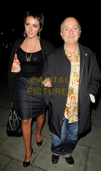 "LOUISE HOBBS & TONY ROBINSON .Press Night for ""Entertaining Mr Sloane"" at the Trafalgar Studios, London, England,  January 30th 2009.full length black coat denim skirt shoes floral print shirt jeans .CAP/CAN.©Can Nguyen/Capital Pictures"