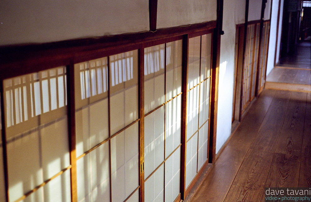 Sunlight streams through the windows and falls on the rice paper walls of the Myoken-ji Buddhist Temple in Kyoto, Japan.