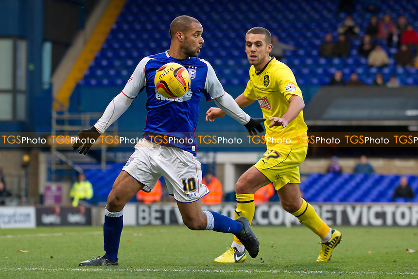 David McGoldrick of Ipswich Town protects the ball from Tom Smith of Huddersfield Town - Ipswich Town vs Huddersfield Town - Sky Bet Championship Football at Portman Road, Ipswich, Suffolk - 07/12/13 - MANDATORY CREDIT: Ray Lawrence/TGSPHOTO - Self billing applies where appropriate - 0845 094 6026 - contact@tgsphoto.co.uk - NO UNPAID USE