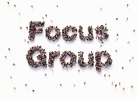 """Overhead view of people forming words """"focus group"""""""