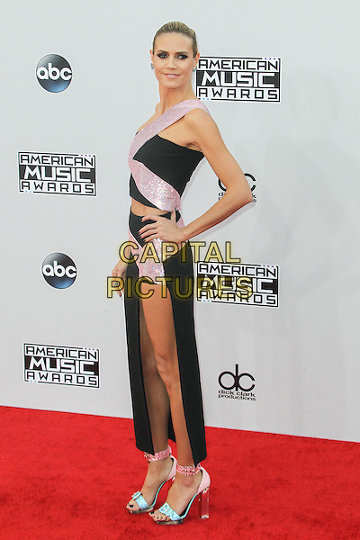 LOS ANGELES, CA - NOVEMBER 23: Heidi Klum attending The 42nd Annual American Music Awards held at the Nokia Theater L.A. on November 23rd, 2014.