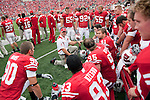 Wisconsin Badgers defensive line coach Charlie Partridge talks to his linemen during an NCAA college football game against the San Jose State Spartans on September 11, 2010 at Camp Randall Stadium in Madison, Wisconsin. The Badgers beat San Jose State 27-14. (Photo by David Stluka)