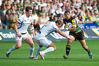 George Pisi of Northampton Saints is tackled by Brett Sturgess of Exeter Chiefs during the Aviva Premiership match between Northampton Saints and Exeter Chiefs at Franklin's Gardens on Sunday 9th September 2012 (Photo by Rob Munro)