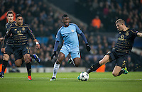 Kelechi Iheanacho of Manchester City attacks as Jozo Simunovic of Celtic slides in & Emilio Izaguirre of Celtic looks on during the UEFA Champions League GROUP match between Manchester City and Celtic at the Etihad Stadium, Manchester, England on 6 December 2016. Photo by Andy Rowland.