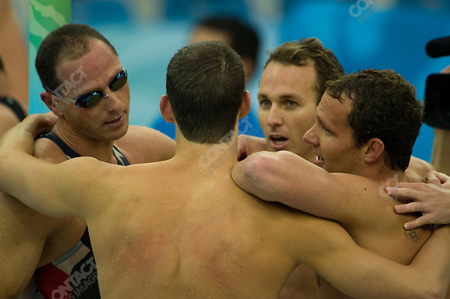 Michael Phelps (back to camera) with his teammates for the, Men's 4x100m Medley Relay. This was Phelp's 8th gold medal of the games. National Aquatics Center, Summer Olympics, Beijing, China, August 17, 2008
