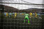 Action from the second-half as Cambrian and Clydach Vale (in blue) take on Cwmbran Celtic at King George's New Field in a Welsh League Division One match, the top division of the Welsh Football League and the second level of the Welsh football league system. The club, formed in 1965 reached the final of the 2018-19 League Cup final and can count on ex-England manager Terry Venables as a former club chairman. Cambrian and Clydach Vale won this match 2-0, watch by a crowd of around 100 spectators.