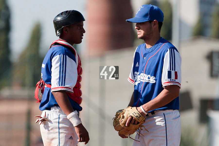 20 August 2010: Closer Joris Navarro of Team France talks to Andy Paz during France 6-5 win over Italy, at the 2010 European Championship, under 21, in Brno, Czech Republic.