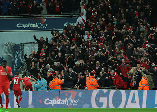 28.02.2016. Wembley Stadium, London, England. Capital One Cup Final. Manchester City versus Liverpool. Liverpool Midfielder Philippe Coutinho scores past Manchester City Goalkeeper Wilfredo Caballero, and climbs the advertising boards to get to his fans,1-1