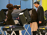 Nevada Gov. Brian Sandoval votes in Reno, Nev., on Tuesday, Nov. 4, 2014. First lady Kathleen Sandoval and their daughters Maddy, 17, and Marisa, 10, are at left. (AP Photo/Cathleen Allison)