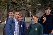 Debrecen, Hungary. Group of five smiling teenage boys, two with Adidas sweatshirts.