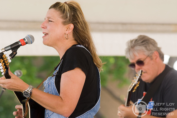 Terri Hendrix (left) and Lloyd Maines perform during the Arbor Daze festival in Euless, Texas