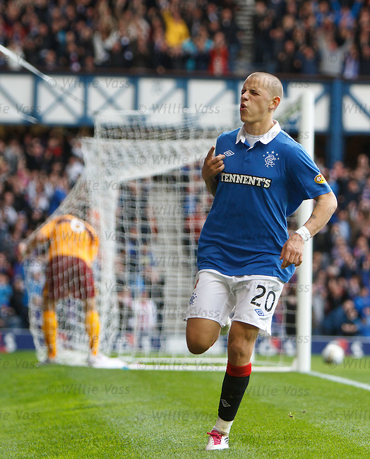 Vladimir Weiss scores his first goal for Rangers as he fires past Motherwell keeper Darren Randolph and celebrates