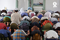 People praying inside a mosque (Licence this image exclusively with Getty: http://www.gettyimages.com/detail/83154233 )