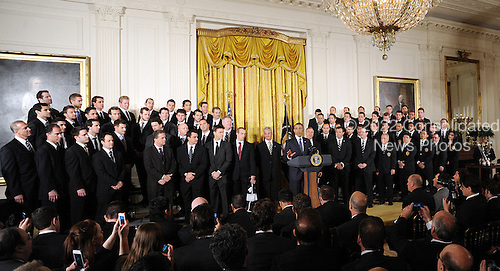 United States President Barack Obama speaks as he welcome the Stanley Cup champion Los Angeles Kings and the Major League Soccer champion LA Galaxy to the White House to honor their 2012 championship seasons in a ceremony in the East Room of the White House March 26, 2013 in Washington, DC. .Credit: Olivier Douliery / Pool via CNP