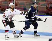 Drew Ellement (Northeastern - 2), Scott Brannon (StFX - 72) - The visiting St. Francis Xavier University X-Men defeated the Northeastern University Huskies 8-5 on Sunday, October 2, 2011, at Matthews Arena in Boston, Massachusetts.