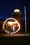 January 27, 2008; Santa Cruz, CA, USA; A fire artist performs at night in front of the Santa Cruz Surfing Museum at Lighthouse Field State Beach in Santa Cruz, CA. Photo by: Phillip Carter
