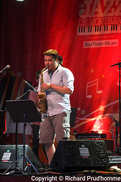 Benjamin Deschamps playing the sax at the Montreal International Jazz Frestival