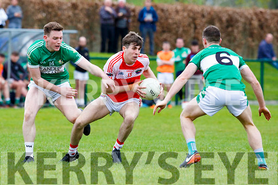 Legion Conor Keane and Jonathan Lyne  track Dingle Conor Geaney during their Club Championship clash in Killarney on Sunday