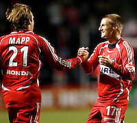 Chicago Fire forward Chris Rolfe (17) congratulates Chicago Fire midfielder Justin Mapp (21) on his assist on Andy Herron's game winning goal.  The Chicago Fire defeated the Los Angeles Galaxy 3-1 in the championship game of the U.S. Open Cup at Toyota Park in Bridgeview, IL on September 27, 2006...