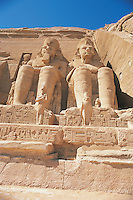 Two of the four massive colossi of Ramses II which decorate the facade of the Temple of Ramses II at Abu Simbel. This temple was built by Ramses II between 1272 and 1242 BC. When Lake Nasser was formed by the <br /> building of the Aswan Dam, this temple would have been flooded and so it was cut into 2,000 huge blocks and reconstructed at a spot 656 feet inland and 212 feet higher than the original site.